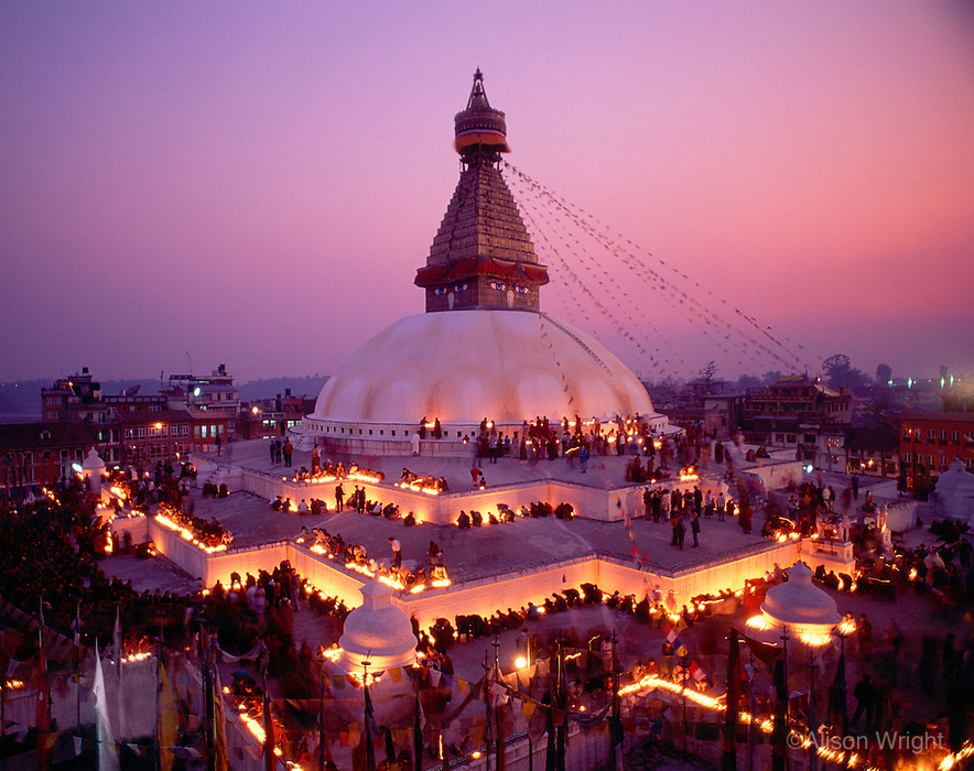 Boudhanath Stupa, Nepal.With more than 6500 Tibetan Buddhist monasteries destroyed in Tibet after the 1959 Chinese invasion many of the monks and lamas have fled their homeland. New monasteries in Boudha, Kathmandu, Nepal have been rebuilt to house the exiled refugees and the new generation of enthusiastic young monks. A Tibetan lama has died and there are 100,000 butter lamps lit in his memory.