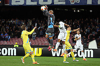 Thursday 27 February 2014<br /> Pictured: Napoli goalkeeper pepe Reina (2nd L) grabs the ball over Ashley Williams of Swansea (3rd L)<br /> Re: UEFA Europa League, SSC Napoli v Swansea City FC at Stadio San Paolo, Naples, Italy.
