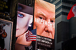 A billboard in Times Square displays an advertisement for billionaire environmental activist Tom Steyer's petition drive to impeach President Donald Trump in New York, U.S., on Saturday, December 30, 2017. Photograph by Michael Nagle