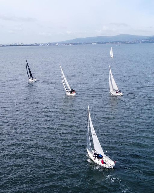Some of the fleet on their way to Glenarm after the Belfast Lough start