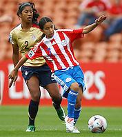 Rebeca Fernandez (PAR) gets to the ball ahead of Lexi Harris (USA)..FIFA U17 Women's World Cup, Paraguay v USA, Waikato Stadium, Hamilton, New Zealand, Sunday 2 November 2008. Photo: Renee McKay/PHOTOSPORT