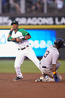 Jeter Downs (2) of the Dayton Dragons attempts to turn a double play as Emilio Gustave (13) of the Bowling Green Hot Rods slides into second base at Fifth Third Field on June 8, 2018 in Dayton, Ohio. The Hot Rods defeated the Dragons 11-4.  (Brian Westerholt/Four Seam Images)