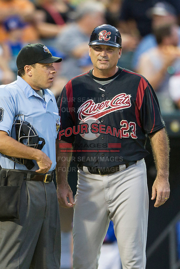 Sacramento River Cats manager Steve Scarsone (23) talks with PCL umpire Brian Reilly during the Pacific Coast League baseball game against the Round Rock Express on June 19, 2014 at the Dell Diamond in Round Rock, Texas. The Express defeated the River Cats 7-1. (Andrew Woolley/Four Seam Images)