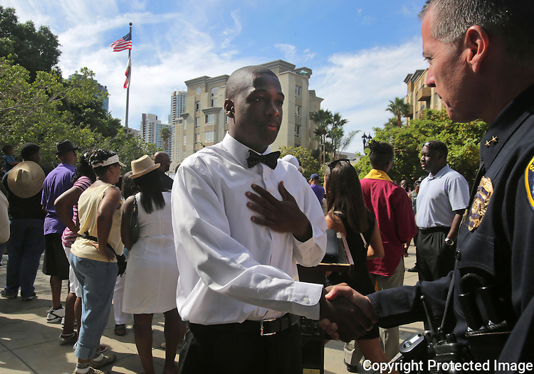 Christian Onwuka, 17, meets San Diego Police Department Assistant Chief Walt Vasquez during a rally for the recent events in Furgeson, Missouri Sunday at the San Diego Police Department. Onwuka was one of the speakers at the event. photo by Bill Wechter