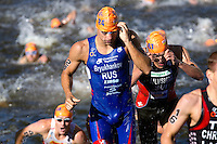 20 JUL 2013 - HAMBURG, GER - Andrey Bryukhankov (RUS) of Russia heads for transition at the end of the swim at the elite men's ITU 2013 World Triathlon Series round in the Altstadt Quarter, Hamburg, Germany (PHOTO COPYRIGHT © 2013 NIGEL FARROW, ALL RIGHTS RESERVED)