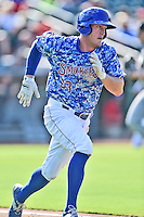 Tennessee Smokies first baseman Jacob Rogers (33) runs to first during a game against the Birmingham Barons on August 2, 2015 in Kodak, Tennessee. The Smokies defeated the Barons 5-2. (Tony Farlow/Four Seam Images)