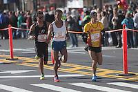 NEW YORK - NOVEMBER 7: Abdelkabir Saji (224) of Italy, Bado Worku Merdessa (200) of the USA, and Jorge Real (228) of the USA, approach the 8 mile mark on 4th avenue in the 2010 New York City Marathon.