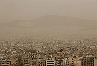 Pictured: Reduced visibility due to red dust over the skyline of Athens Greece. Monday 26 March 2018<br /> Re: Strong southern winds from Africa have carried red dust over to Greece.