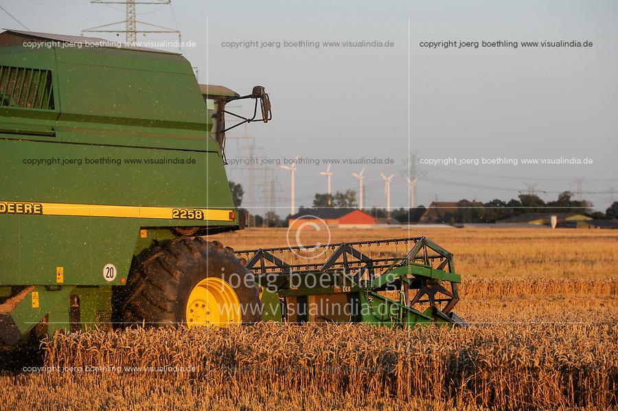 GERMANY, grain harvest and wind turbine / Getreideernte und Windkraftanlage in Steinburg bei Glueckstadt