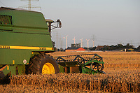 GERMANY, grain harvest and wind turbine / Getreideernte und Windkraftanlage in Steinburg bei Glueckstadt