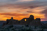 The sun sets behind Pueblo Del Arroyo. The site of Pueblo Del Arroyo lies within the Chaco Culture National Historic Park in New Mexico.