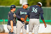 Pulaski Mariners pitching coach Nasusel Cabrera #22 has a chat on the mound with pitcher Rigoberto Garcia #36 and catcher Tyler Marlette #30 during the game against the Bluefield Blue Jays at Bowen Field on July 1, 2012 in Bluefield, West Virginia.  The Mariners defeated the Blue Jays 4-3.  (Brian Westerholt/Four Seam Images)