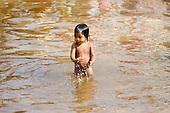 Altamira, Brazil. Kayapo child in the river.