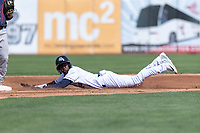 Kane County Cougars second baseman Geraldo Perdomo (4) slides into second base during a Midwest League game against the Cedar Rapids Kernels at Northwestern Medicine Field on April 28, 2019 in Geneva, Illinois. Kane County defeated Cedar Rapids 3-2 in game one of a doubleheader. (Zachary Lucy/Four Seam Images)