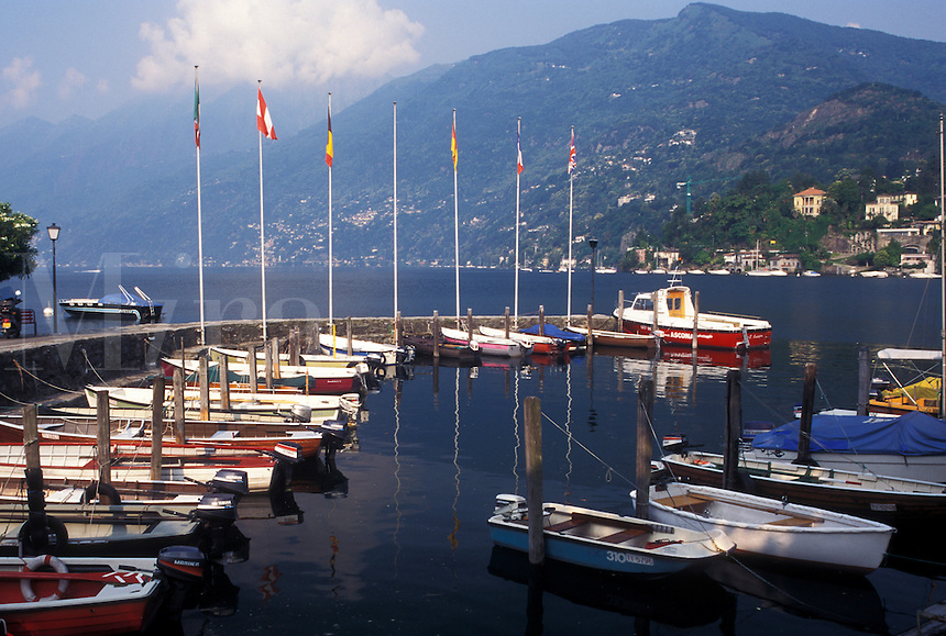 Switzerland, Ticino, Ascona, Boats docked in the harbor along the lakefront of Lake Maggiore in the city of Ascona.