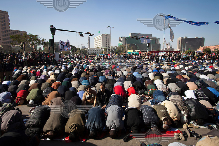 People praying in Tahrir Square during a protest demanding the immediate transfer of power from Egypt's military rulers, SCAF (Supreme Council of the Armed Forces), to a civilian government.