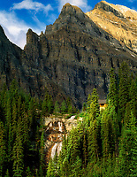 Tea house at Agnes Lake with waterfall. Banff National Park, Canada