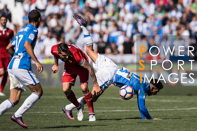 Vitolo of Sevilla FC competes for the ball with Carl Medjani of Deportivo Leganes during their La Liga match between Deportivo Leganes and Sevilla FC at the Butarque Municipal Stadium on 15 October 2016 in Madrid, Spain. Photo by Diego Gonzalez Souto / Power Sport Images