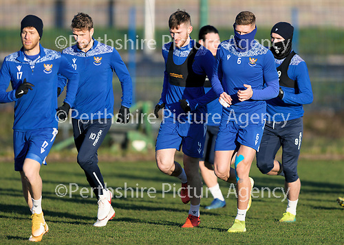 St Johnstone Training…. 22.12.20<br />Liam Gordon pictured all wrapped up against the cold during training at McDiarmid Park running alongside Jamie McCart<br />Picture by Graeme Hart.<br />Copyright Perthshire Picture Agency<br />Tel: 01738 623350  Mobile: 07990 594431