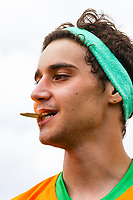 London, UK on Sunday 31st August, 2014. Luke Brooks of The Janoskians bites on his medal during the Soccer Six charity celebrity football tournament at Mile End Stadium, London.