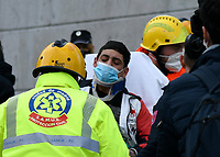 MADRID, SPAIN - JANUARY 20: A man is receiving medical assistance from first responders attend a emergency after a explosion on January 20 in Madrid, Spain.  (Photo by Joan Amengual / VIEWpress