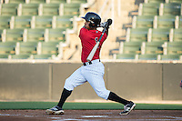 Dante Flores (1) of the Kannapolis Intimidators follows through on his swing against the Hagerstown Suns at Kannapolis Intimidators Stadium on May 4, 2016 in Kannapolis, North Carolina.  The Intimidators defeated the Suns 7-4.  (Brian Westerholt/Four Seam Images)