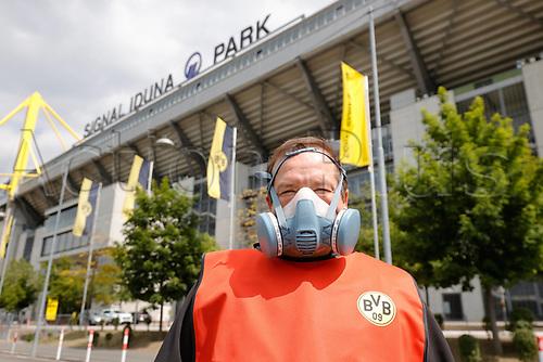 16th May 2020, Signal Iduna Park, Dortmund, Germany; Bundesliga football, Borussia Dortmund versus FC Schalke;  A Dortmund steward wearing an elaborate Face Mask, in front of the stadium