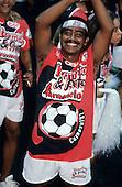 Salvador, Brazil. Members of the Vermelho e Preto Karamelo carnival band dancing.