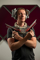 BNPS.co.uk (01202) 558833<br /> Pic: Zachary Culpin/BNPS<br /> <br /> Pictured: Matt Nunn of Flints Auctions pictured modelling the Dr Who Props that are set to sell. He's pictured wearing a 'Correction helmet' on his head, he has a prop from Dr Who's Medikit around his neck, he's holding two guns from the 1978 episode'Invasion of Time' and he's wearing a ring on his hand from 1981 episode 'Keeper of Traken' 1981, starring Tom Baker.<br /> <br /> Scarce props used in Dr Who that were given to a crew member for his children to play with after filming have emerged for sale.<br /> <br /> The memorabilia that featured in episodes starring Tom Baker as the Doctor in the 1970s includes spage-age weapons, a Tardis control dial and a correction helmet.