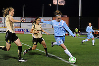Collette McCallum (14) of Sky Blue FC is defended by Leigh Ann Robinson (7) and Tina DiMartino (5) of FC Gold Pride. Sky Blue FC and FC Gold Pride played to a 1-1 tie during a Women's Professional Soccer match at TD Bank Ballpark in Bridgewater, NJ, on April 11, 2009.