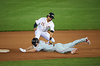 Peoria Javelinas second baseman Alex Blandino (15) tags out Aaron Brown (31) sliding into second during an Arizona Fall League game against the Glendale Desert Dogs on October 19, 2015 at Peoria Stadium in Peoria, Arizona.  Glendale defeated Peoria 4-2.  (Mike Janes/Four Seam Images)