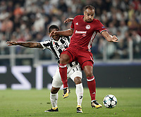 Football Soccer: UEFA Champions League Juventus vs Olympiacos Allianz Stadium. Turin, Italy, September 27, 2017. <br /> Olympiacos' Vadis Odjidja (r) in action with Juventus Douglas Costa (l) during the Uefa Champions League football soccer match between Juventus and Olympiacos at Allianz Stadium in Turin, September 27, 2017.<br /> UPDATE IMAGES PRESS/Isabella Bonotto