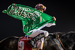 DUBAI, UNITED ARAB EMIRATES - MARCH 25: Mike Smith atop Arrogate #9, displays a flag that was given to him by a local, after winning the Dubai World Cup at Meydan Racecourse during Dubai World Cup Day on March 25, 2017 in Dubai, United Arab Emirates. (Photo by Douglas DeFelice/Eclipse Sportswire/Getty Images)