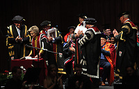 Pictured L-R: Professor Richard B Davies, watches on as Hillary Clinton signs a book after being awarded her honorary degree at Swansea University Bay Campus. Saturday 14 October 2017<br /> Re: Hillary Clinton, the former US secretary of state and 2016 American presidential candidate will be presented with an honorary doctorate during a ceremony at Swansea University's Bay Campus in Wales, UK, to recognise her commitment to promoting the rights of families and children around the world.<br /> Mrs Clinton's great grandparents were from south Wales.