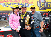 Aug 19, 2018; Brainerd, MN, USA; NHRA top fuel driver Billy Torrence (center) celebrates with wife Kay Torrence (left) and son Steve Torrence after winning the Lucas Oil Nationals at Brainerd International Raceway. Mandatory Credit: Mark J. Rebilas-USA TODAY Sports