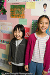 Public Elementary School Grade 3 two girls posing in corridor height difference vertical