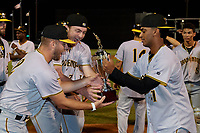 Bradenton Marauders Nick Dombkowski (12) and Alex Roth (32) get the trophy from Carlos Campos (31) after clinching the Low-A Southeast Championship Series with a sweep of the Tampa Tarpons on September 24, 2021 at George M. Steinbrenner Field in Tampa, Florida.  (Mike Janes/Four Seam Images)