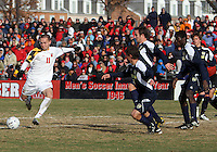 Casey Townsend #11 of the University of Maryland takes a shot past the defense of the University of Michigan during an NCAA quarter-final match at Ludwig Field, University of Maryland, College Park, Maryland on December 4 2010.Michigan won 3-2 AET.