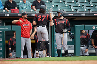 Indianapolis Indians Cole Tucker (27) high fives Will Craig (right) and manager Brian Esposito (left) after hitting a home run during an International League game against the Buffalo Bisons on June 20, 2019 at Sahlen Field in Buffalo, New York.  Buffalo defeated Indianapolis 11-8  (Mike Janes/Four Seam Images)