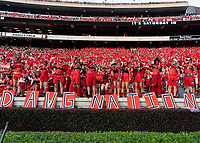 ATHENS, GA - SEPTEMBER 18: The Spike Squad cheers for their team before a game between South Carolina Gamecocks and Georgia Bulldogs at Sanford Stadium on September 18, 2021 in Athens, Georgia.