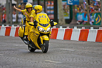The LCL lead motorcycle guides the Tour de France professional cyclists onto the Champs Elysees in Paris, France on July 25th 2010