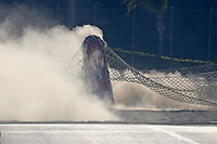 Feb 7, 2020; Pomona, CA, USA; NHRA nostalgia funny car driver Dan Horan crashes into the sand trap catch net containment system after his parachutes failed to deploy  during qualifying for the Winternationals at Auto Club Raceway at Pomona. Horan was uninjured in the incident. Mandatory Credit: Mark J. Rebilas-USA TODAY Sports
