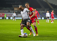 30th December 2020; Liberty Stadium, Swansea, Glamorgan, Wales; English Football League Championship Football, Swansea City versus Reading; Andre Ayew of Swansea City  controls the ball while under pressure from Michael Morrison of Reading FC