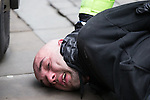 """© Joel Goodman - 07973 332324 . 28/03/2015 . Manchester , UK . A man is arrested . Approximately 100 neo-Nazis gather in Manchester for """" White Pride Worldwide day """" . Photo credit : Joel Goodman"""