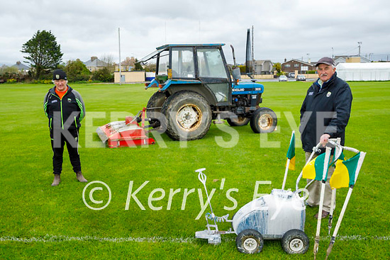 Cutting the grass and lining the Caherslea GAA ground on Sunday as the Kerry Senior hurlers will be training there on their return to training. Front right: Joe Wallace and Ger McCarthy.