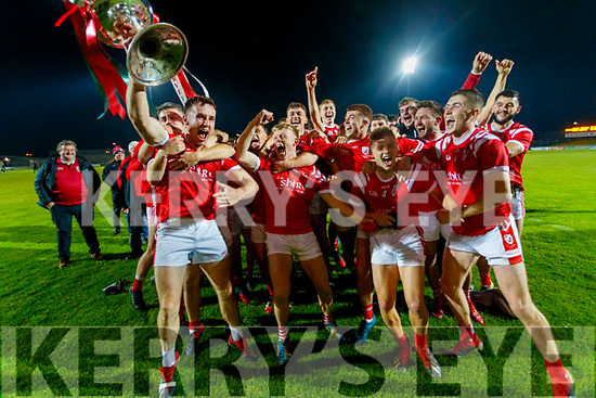 East Kerry captain Dan O'Donoghue lifts the Bishop Moynihan cup as his team-mates celebrate after the Kerry County Senior Football Championship Final match between East Kerry and Mid Kerry at Austin Stack Park in Tralee on Saturday night.