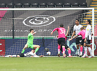 1st May 2021; Liberty Stadium, Swansea, Glamorgan, Wales; English Football League Championship Football, Swansea City versus Derby County; Freddie Woodman of Swansea City is beaten by Tom Lawrence of Derby County's header to score his sides first goal for 0-1 in the 48th minute