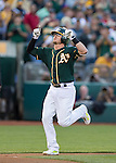 Josh Donaldson celebrates his 3 run home run as he heads for home plate.<br /> Boston Red Sox at Oakland A's at O.Co coliseum in Oakland, June 20, 2014