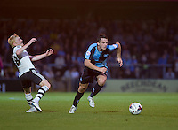 Stephen McGinn of Wycombe Wanderers leaves Ben Pringle of Fulham during the Capital One Cup match between Wycombe Wanderers and Fulham at Adams Park, High Wycombe, England on 11 August 2015. Photo by Andy Rowland.