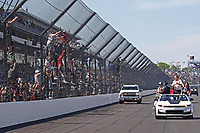 30th May 2021, Indianapolis, Indiana, USA; NTT Indy Car Series driver Helio Castroneves does a victory lap in the pace car while fans climb the fence after winning the 105th running of the Indianapolis 500 on May 30, 2021 at the Indianapolis Motor Speedway in Indianapolis, Indiana.